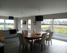 We changed our minds so many times when it came to the open plan living area and kitchen. Munster Joinery, Stool Cushion, Scandinavian Dining Chairs, L Shaped Kitchen, Georgian Homes, Open Plan Kitchen, Open Plan Living, Sitting Area, New Builds