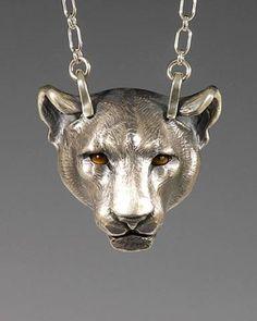 Silver Panther w/ Tigereye Eyes . Cast silver, Tigereye eyes. 1 3/8 inch length. $ 250.00
