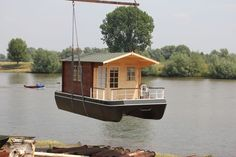 The floating cottage is a boat with good navigational skills. The base of the… Trailer Casa, Tiny Boat, Shanty Boat, Lakefront Property, Floating House, Boat Building, Rustic Design, Architecture, House Plans