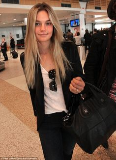 A model entrance: Practicing her strut through Sydney Airport was Australian model Bridget Malcolm, who touched down off an interstate flight on Monday