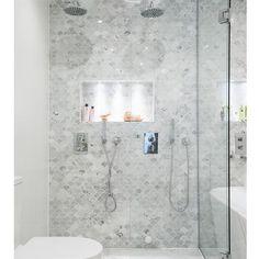 Bathroom with fish scale tiles, oak vanity, Carrara marble bowl, round mirror an… – Marble Bathroom Dreams Condo Bathroom, Bathroom Renos, Bathroom Renovations, Small Bathroom, Bathroom Shower Tiles, Bathroom Ideas, White Mosaic Bathroom, Fish Bathroom, Shower Niche