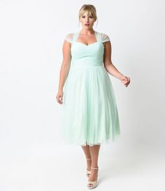 This gorgeous mesh dress is perfect for a garden party, bridesmaid dress, or school dance! This vintage design has pleat...Price - $128.00-u4RagIB3