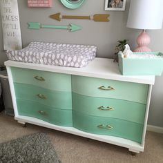 Beautiful vintage dresser redone in Annie Sloan chalk paint ombré mint & white. Gold handles & feet. Nursery changing table mint and gold.