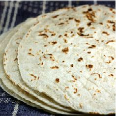 Homemade Flour Tortillas - a simple dough cut into pieces, rolled into circles, then  30 to 45 seconds per side on an ungreased hot skillet.  No mess and too easy!