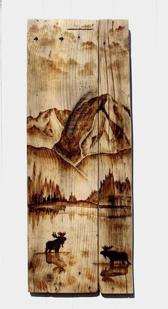 A stunning Maine mountain scene, painted with wood stain on reclaimed barn boards.
