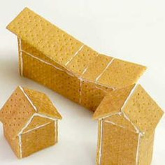 So creative, affordable and EASY- Graham Cracker Gingerbread Houses or Nativity Scene. Smooth over graham cracker dimples with royal icing and a bench scraper. Use Marshmallow/Icing to hold together and for snow then add colorful gumdrops and candies. Graham Cracker House, Graham Cracker Gingerbread House, Gingerbread House Parties, Christmas Gingerbread House, Gingerbread Houses, Gingerbread Cookies, Diy Christmas Crackers, Christmas Goodies, Christmas Baking