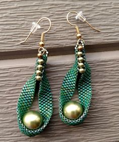 "Light green nested pearl (Swarovski), 2.5"" long, gf earwires"