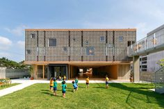 """Hanazono Kindergarten designed by HIBINOSEKKEI + youji no shiro in Japan  The centres' design language of a system of grid-like squares lends itself to a variety of expressions. Including """"random"""" interspersed square windows dotted throughout the facade"""