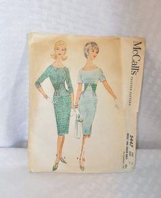 https://www.etsy.com/listing/185780237/early-1960s-vintage-wiggle-sheath-dress?ref=market