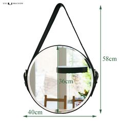 Deze prachtige ronde spiegel Edison met zwart leren riem als ophang-systeem is nu verkrijgbaar bij Usi Maison voor de beste prijs en gratis levering!