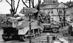 The cavalry recon squadron of 9th Armored Division occupies the town square in Pegau, Germany on 4th April 1945.