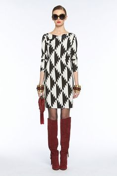 Love thesimple cut of this DVF dress.  And the boots, oh, the boots!