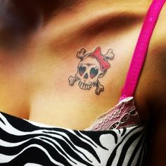 Skull tattoo with a pink bow
