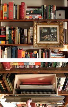 Hidden shelf storage using artwork....simple and really cool