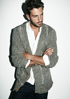 Casual grey cardigan over a white shirt.