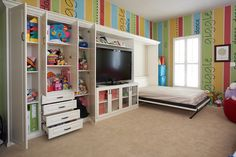 Playroom, guest room and media center all in one!  www.tailoredliving.com/reston