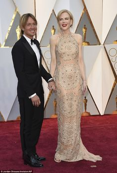 Smitten: Keith and Nicole are known for packing on the PDA on the red carpet...
