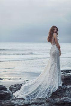 This Ariel-inspired gown is playful, yet elegant. A subtle flared train is reminiscent of a mermaid's silhouette, while sparkling sequins mimic the play of light across the moonlit sea. Affordable Wedding Dresses, Wedding Dress Sizes, Designer Wedding Dresses, Disney Collection, Spring Collection, Tuxedo Wedding, Bridal And Formal, Bridal Boutique, Formal Gowns