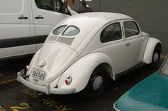 My Grandpa had a black 1953 Volkswagen Beetle like this one. I used to have to stand in the back and hold the straps because he pulled the seat out and had his tools there on a board. He sold it in the mid 1970's.
