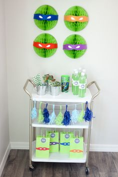 Teenage Mutant Ninja Turtle Party - clever use of party decor + we love the cart! #TMNT