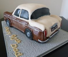 I just copied the picture – and its only now my other half tells me its a Minx.  The colours and the number plate match the photos for this 90th birthday cake.   Hillman Hunter Birthday Cake