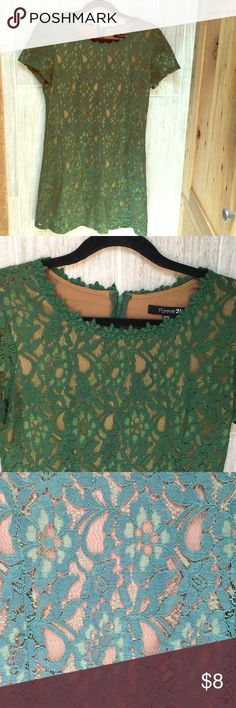 Green lace 50's style dress Dark and light green lace brings interest in this short sleeved mini dress. Very comfortable. Nude lining and zipper back. True brand: forever 21 Anthropologie Dresses Mini
