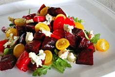 Beet Salad  4 medium-sized red beets  3 tablespoons extra-virgin olive oil  2 tablespoons balsamic vinegar 1 teaspoon Dijon mustard 1 large tomatoes, chopped 1 cup cherry tomatoes, halved [I used yellow cherry tomatoes] 1 cup baby arugula 1-2 ounces Cambazola, gorgonzola, or blue cheese 1/2 teaspoon kosher salt 1/4 teaspoon freshly ground black pepper