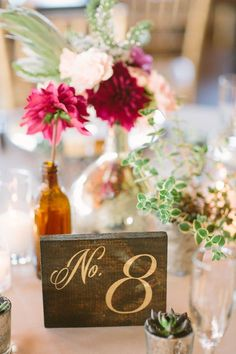 wood table numbers with gold paint, photo by Apryl Ann Photography http://ruffledblog.com/romantic-hickory-street-annex-wedding #weddingideas #tablenumbers