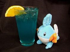Mudkip (Pokemon Cocktail)    Ingredients:  1 oz. Fresh squeezed orange juice  1.5 oz. blue curacao  2 oz white wine. (the fruitier the better)  Fill with citrus soda    Directions: For this cocktail, inspired by the sangria, shake the first three ingredients and pour into a glass.  Top the drink with your favorite citrus soda and place an orange slice on the rim of the glass as a garnish.    (Drink created and photographed by Mel the Office Gamer Girl)