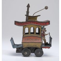 A Tin Lithograph Toonerville Trolley with Book
