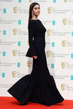 Monica Bellucci What could be black and boring is memorable and quirky, thanks to the bell sleeves and stepped hem of Bellucci's covered-up Alaïa number.