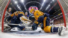 Nashville, TN - May 2: Ryan Ellis #4 makes a save in the crease with Pekka Rinne #35 of the Nashville Predators against Vladimir Tarasenko #91and Jaden Schwartz #17 of the St. Louis Blues in Game Four of the Western Conference Second Round during the 2017 NHL Stanley Cup Playoffs at Bridgestone Arena on May 2, 2017 in Nashville, Tennessee.