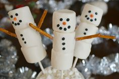 Adorable snowman marshmallow pops - easier and yummier than cake pops--Dip top in Candy Coating to make a HAT and add a Dipped Mini Marshmallow for a top hat!