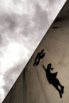 "Banksy's wonderful mural / graffiti gracing a wall of an ""UP"" building slated to float into the clouds:"