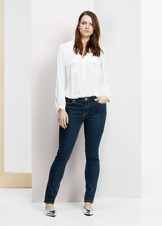 I like the cut and style of this shirt for fall. Long sleeves for cold rainy days. It's fitted, but not too clingy. Still girly, and not too business-y