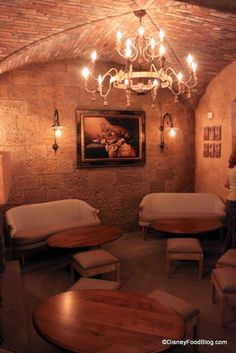 Love this cozy fireplace room at #DisneyWorld's Tutto Gusto. You'd never know you were in a theme park!