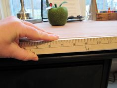 Sew Many Ways...: Sewing/Craft Room Ideas and Updates...Attach a ruler to the edge of the table or desk.