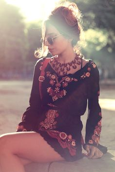 I think this is a romper, if it's a shirt dress it's pretty cute too. Love the embroidered pattern;I like ethnic patterns that give something to the piece overall, than pattern just for pattern's sake. & as always, I'm a sucker for dark colors with a splash of gold and red.