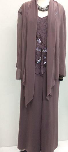 3 Pieces With matching chiffon jacket Lined pants with full elastic, Top cut across which is very flattering Long chiffon jacket. Very comfortable to wear an