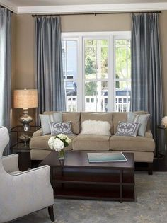 Living Room White, Slate Blue, Tan, And dark brown Color Scheme Design