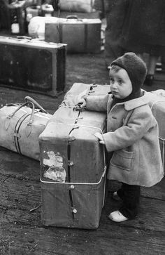APRIL 1948: Ron Kantor, 1, from Paris, stood guard over his parents' baggage on the wharf after arriving in Melbourne. Picture: Herald Sun Image Library