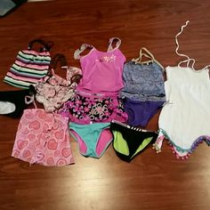 EUC girls size 6 and 7 swim suits 12 pieces you get all 12 pieces one is a cover up then few sets of suits and few misc pieces to mix and match ready for summer they are all so cute Swim Bikinis