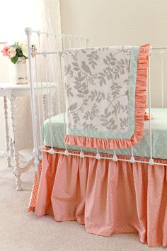 New bumperless crib bedding for baby girl nursery featuring mint and coral with gray botanical bird designer fabric blanket. So sweet!