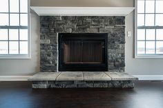 Love the nuet grays in this fireplace. Also this is one built by wayne homes.