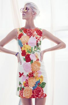 Love the figure skimming silhouette of this cheerful sheath dress.