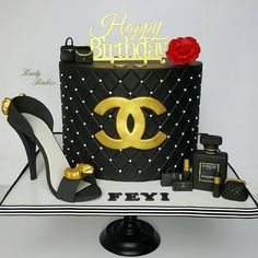 from - Monochrome hues with touches of gold, and a splash of red 🖤💛❤. Chanel themed cake ordered by an extremely special lady. Favourite part was making that pretty Chanel perfume bottle 💖. Birthday Present Cake, Special Birthday Cakes, Pretty Birthday Cakes, Birthday Cakes For Women, Coco Chanel Cake, Channel Cake, Chanel Birthday Party, Brithday Cake, Queen Cakes