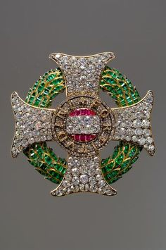 Grand Cross of the Holy Order of St. Stephen, 1765, the cross is set with diamonds, rubies and emeralds and is laid on a laurel wreath of emeralds set in gold, and was first owned by Emperor Joseph II. He gave it as a present to Field Marshal Gideon Laudon after the capture of Belgrade in 1789.