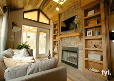 It is easy to assume that a tiny house means that you have to bend down to walk into a room or take turns passing people in the hallway, but with a little architectural ingenuity tiny homes are actually very livable. This tiny home is also a luxurious cabin that feels like you have plenty of room with high ceilings and beautiful wood floors.