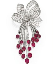 Oval-Shaped Ruby And Round And Baguette Diamond Brooch By Van Cleef & Arpels,    c.1950's Sotheby's