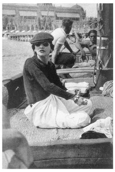 """CHANEL - Gabrielle Chanel on Roussy Sert's yatch in front of the Lido of Venice   1936 - """"Elegance is not the perogative of those who have just escaped from adolescence, but of those who have already taken possession of their future."""" - Coco Chanel"""